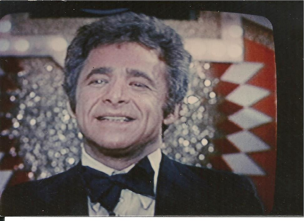 TV host Chuck Barris about to introduce Big Chuck for his moment in the spotlight on the Gong Show!